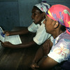 Literacy, women reading a newspaper, adult education