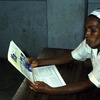 Literacy, woman reading a newspaper, adult education