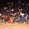 Outdoor movie show in a village, African audience