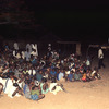 Outdoor movie show in a village, African audience, screen