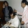 Men working at the press agency Anta.