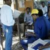 Men reading newspaper, rural press.