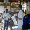 People reading newspaper, rural press.
