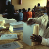 Manufacture of educational manuals. Literacy. Woman arranging manuals.