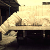 Loading of cotton bales, textile workshop, factory