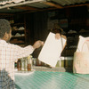 Rural press. Man buying newspaper.