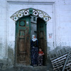 Typical village, doorway decoration, woman, child