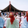 Traditional dancers and singers in front of the official grandstand of the Mous
