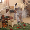 Girls preparing tea during a religious ceremony