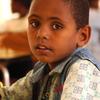 School-boy in class
