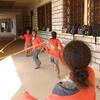 Young schoolchildren skipping in a schoolyard