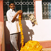 A Man making Marigold garlands for an upcoming Holy festival.