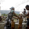 Haitians wash themselves in a public fountain near the Haitian National Palace