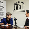 Ms Irina Bokova, Director-General of UNESCO with a journalist of the Chinese pr