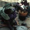 Traditional cooking, rice and fish, African women