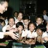 Children with their teacher, school, classroom, laughter.