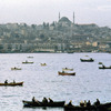 View on Bosphorus bank and port activities, boats, houses and mosque