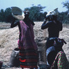 Experimental agricultural area, African women pouring corn in sacks