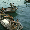 Young Chinese children on fishing boats
