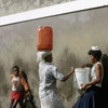 Everyday life, water gathering, women carrying water, bucket