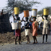 Everyday life, women carrying water buckets