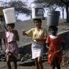 Everyday life, women and teenagers carrying water buckets