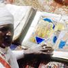 Churchman showing an illuminated gospel-book, copt, man