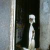 Churchman standing at the entrance of Bichena Church, man, copt