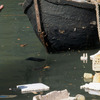 Venitian canal and small boat, pollution