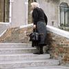 Everyday life in Venice, woman, stairs, bridge