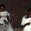 Adult literacy programme, young women reading, adult education
