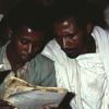 Adult literacy programme, adult education, men reading
