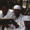 Literacy class in a religious school, adult education, men, book