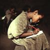 Literacy class, young girl writing