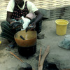 Traditional cooking, rice and fish, African woman