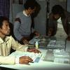 Men working at rural press agency.