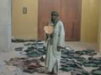Man holding a burnt manuscript, Timbuktu