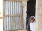 A young girl looks out the window at school in Sine-Saloum, Senegal.