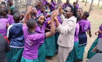 Joyous celebration between TUSEME Club members and women academicians and proffesionals during the International Day of the Girl Child