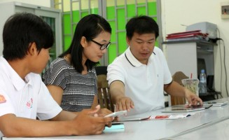 Prum Chanlang enlists the help of a BEEP teacher in Phnom Penh