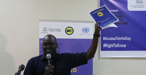 Hon. Nicodemus Ajaik, South Sudan Information Commissioner launches the 3-year Access to Information Strategic Plan during the Access to Information Day event in Juba ©UNESCO Juba Office