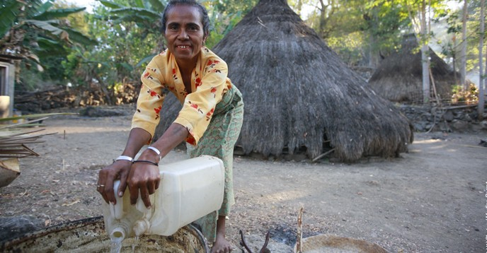 A woman from Pune, Timor-Leste, collects water for her home.
