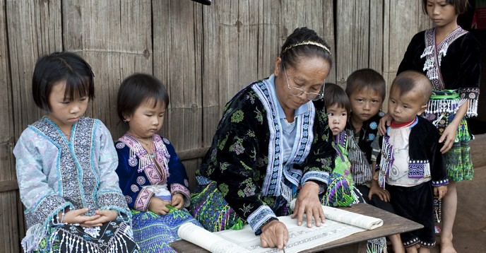 Meo children learning lessons, Thailand